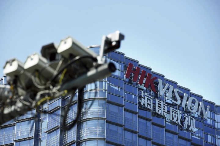 "In this Wednesday, May 22, 2019, photo, surveillance cameras are seen outside the headquarters of Chinese security technology company Hikvision in Hangzhou in eastern China's Zhejiang province. Stepping up a propaganda offensive against Washington, China's state media on Friday accused the U.S. of seeking to ""colonize global business"" by targeting telecom equipment giant Huawei and other Chinese companies. (Chinatopix via AP)"