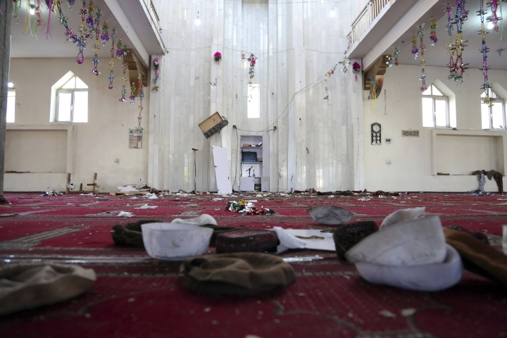 Remains of belongings of people inside a mosque after a bomb explosion during Friday prayer on the outskirts of Kabul, Afghanistan, Friday, May 24, 2019. According to Kabul police chief's spokesman, Basir Mujahid, the bomb was concealed in the microphone used to deliver the sermon. The prayer leader, Maulvi Samiullah Rayan, was the intended target, the spokesman added. (AP Photo/Rahmat Gul)