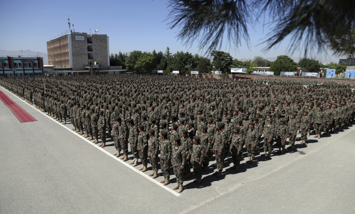 Afghan National Army soldiers attend their graduation ceremony from a 3-month training program at the Afghan Military Academy in Kabul, Afghanistan, Monday, May 27, 2019. (AP Photo/Rahmat Gul)