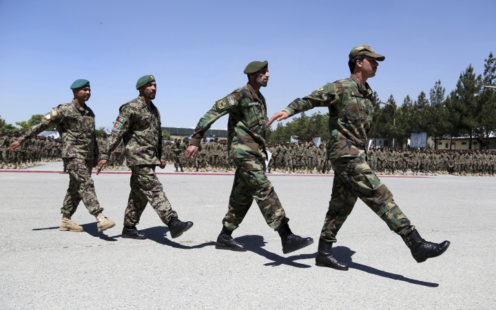 Afghan National Army soldiers march during their graduation ceremony from a 3-month training program at the Afghan Military Academy in Kabul, Afghanistan, Monday, May 27, 2019. (AP Photo/Rahmat Gul)