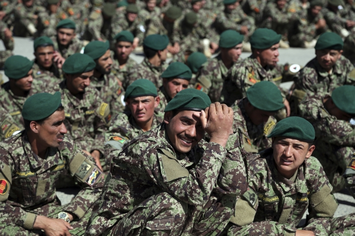 Afghan National Army attend their graduation ceremony from a 3-month training program at the Afghan Military Academy in Kabul, Afghanistan, Monday, May 27, 2019. (AP Photo/Rahmat Gul)