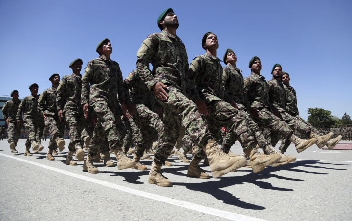 Afghan National Army march during their graduation ceremony from a 3-month training program at the Afghan Military Academy in Kabul, Afghanistan, Monday, May 27, 2019. (AP Photo/Rahmat Gul)