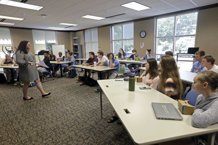 In this photo taken Tuesday, May 21, 2019, 11th grade students learn about the D-Day invasion at Normandy from social sciences teacher Kasey Turcol during an advanced placement history class at Crossroads FLEX school in Cary, N.C. Turcol has just 75 minutes to explain to her high school students the importance of D-Day - and if this wasn't the 75th anniversary of the turning point in World War II, she wouldn't devote that much time to it.(AP Photo/Gerry Broome)