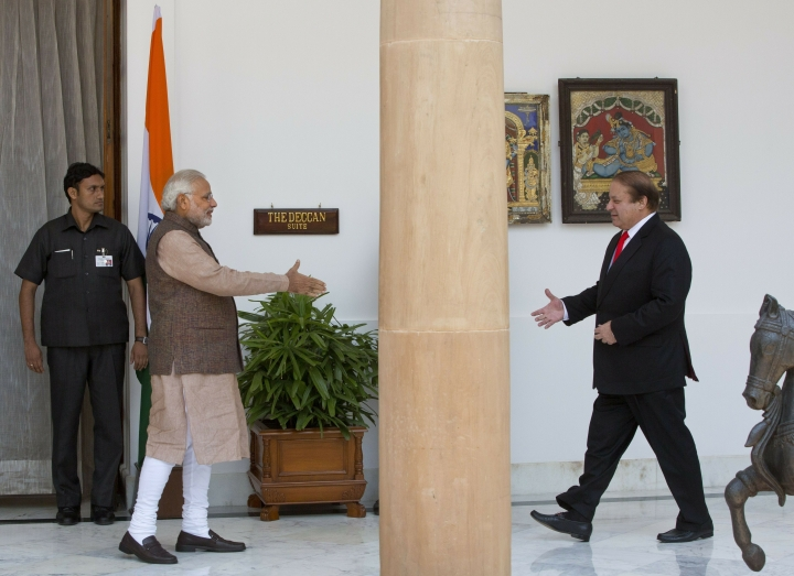 FILE - In this May 27, 2014 file photo, Indian Prime Minister Narendra Modi, left, walks to shake hand with his Pakistani counterpart Nawaz Sharif before the start of their meeting in New Delhi, India. Modi won a second term in office in May, 2019, by presenting a muscular image to voters by ordering an air strike inside Pakistan in response to a suicide attack on Indian paramilitary forces in troubled Kashmir ahead of national elections. (AP Photo/Manish Swarup, File)