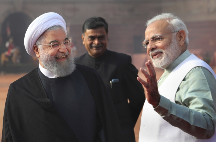 FILE - In this Feb. 17, 2018 file photo, Indian Prime Minister Narendra Modi, right, talks to Iranian President Hassan Rouhani, left, during a ceremonial reception for Rouhani at the Indian presidential palace in New Delhi, India. Modi won a second term in office in May, 2019, by presenting a muscular image to voters by ordering an air strike inside Pakistan in response to a suicide attack on Indian paramilitary forces in troubled Kashmir ahead of national elections. But he will now be required to navigate deftly in a climate of deteriorating trade relations between the United States and China and its fallout on India and rising tensions between the United States and Iran. (AP Photo/Manish Swarup, File)