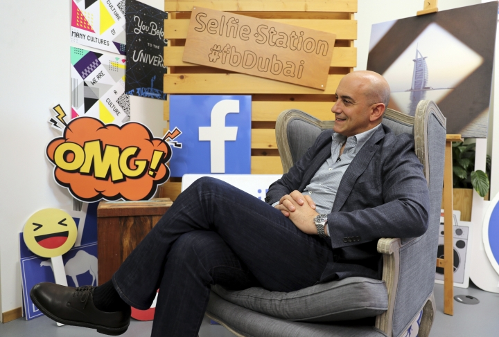 In this Monday, May 20, 2019 photo, Facebook's Managing Director for the Middle East and North Africa, Ramez Shehadi speaks to The Associated Press at the Facebook office in Dubai, United Arab Emirates. The Muslim holy month of Ramadan, with its long days of fasting and prayer meant to draw worshippers closer to God and away from worldly distractions, is being reshaped by technology. People in the Middle East are spending close to 58 million more hours on Facebook and watching more YouTube videos than at any other time of the year, making Ramadan the biggest moment of the year for advertisers. (AP Photo/Kamran Jebreili)