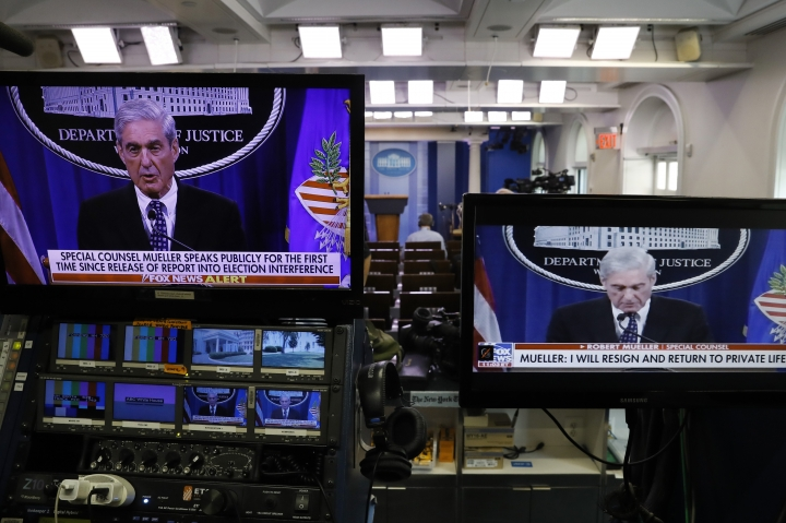 Television screens in the briefing room of the White House show a live statement from special counsel Robert Mueller as he speaks at the Justice Department, Wednesday May 29, 2019, in Washington. (AP Photo/Jacquelyn Martin)