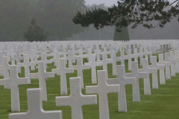 FILE - In this June 6, 2018, file photo, headstones at the Colleville American military cemetery, in Colleville sur Mer, western France. The world will turn its eyes to the beaches of France to mark the 75th anniversary of the D-Day. The United States' representative at the solemn ceremony in Normandy will be President Donald Trump, whose complicated relationship with the armed forces includes allegations of draft dodging, feuds with Gold Star families and considerations of pardoning soldiers accused of war crimes. (AP Photo/David Vincent, File)