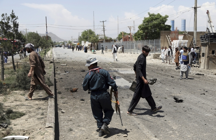 Afghan police arrive at the site of a suicide car bomb in Kabul, Afghanistan, Friday, May 31, 2019. In a second suicide attack in as many days to rattle the Afghan capital, a car bomb targeting a U.S. convoy exploded early Friday morning in an eastern neighborhood, police said. (AP Photo/Rahmat Gul)