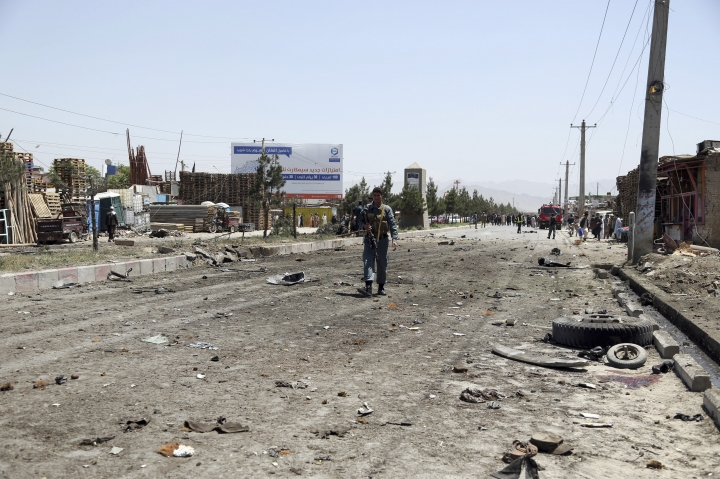 An Afghan police officer arrives at the site of a suicide car bomb in Kabul, Afghanistan, Friday, May 31, 2019. In a second suicide attack in as many days to rattle the Afghan capital, a car bomb targeting a U.S. convoy exploded early Friday morning in an eastern neighborhood, police said. (AP Photo/Rahmat Gul)