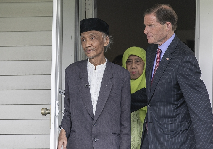 Sujitno Sajuti and wife Dhalia walk out of the Unitarian Universalist Church with Sen. Richard Blumenthal, D-Conn., Friday, May 31, 2019 in Meriden, Conn. Sajuti, a former Fulbright scholar who has been fighting deportation to his native Indonesia left the sanctuary of a Connecticut church Friday after 598 days. Sujitno Sajuti had been living inside Meriden's Unitarian Universalist church with his wife, Dahlia, since being ordered by Immigration and Customs Enforcement in 2017 to board a plane. (Dave Zajac/Record-Journal via AP)