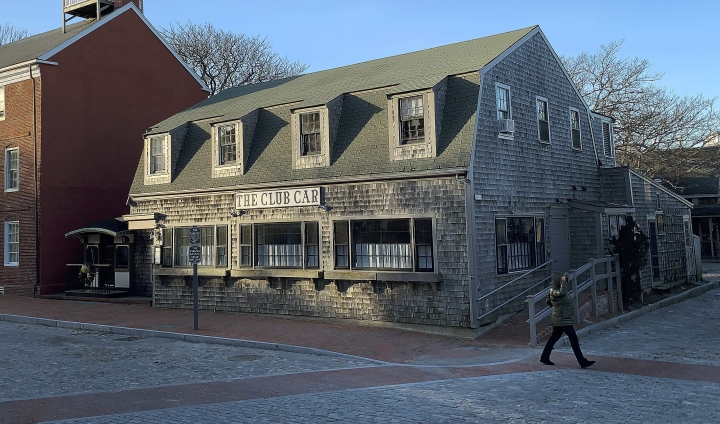 FILE - In this Jan. 7, 2019 file photo, a pedestrian walks past The Club Car Restaurant on Monday, J in Nantucket, Mass. Actor Kevin Spacey is accused of groping the teenage son of a former Boston TV anchor in the restaurant's crowded bar in 2016. On Thursday, May 30, Nantucket District Court Judge Thomas Barrett ruled that the restaurant must hand over any surveillance footage taken there on the night in question. (AP Photo/Rodrique Ngowi, File)