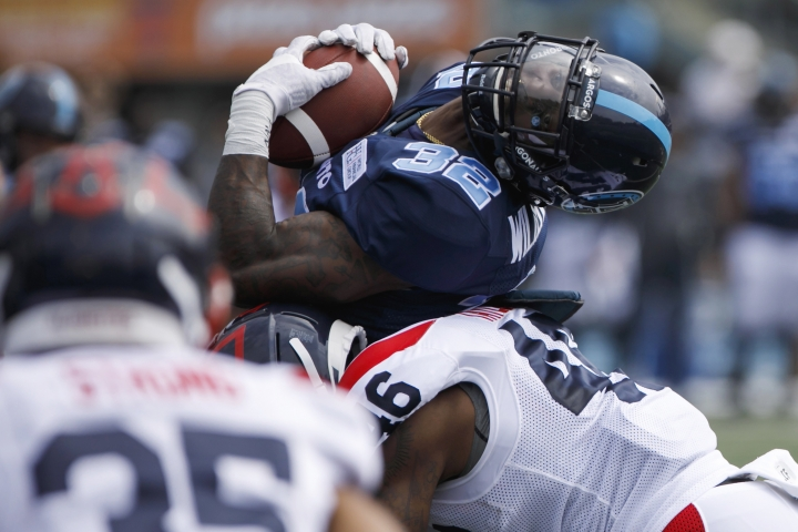 Toronto Argonauts' James Wilder Jr. (32) is hit by Montreal Alouettes' Paris Taylor during a preseason CFL football game in Toronto, Thursday, May 30, 2019. (Cole Burston/The Canadian Press via AP)
