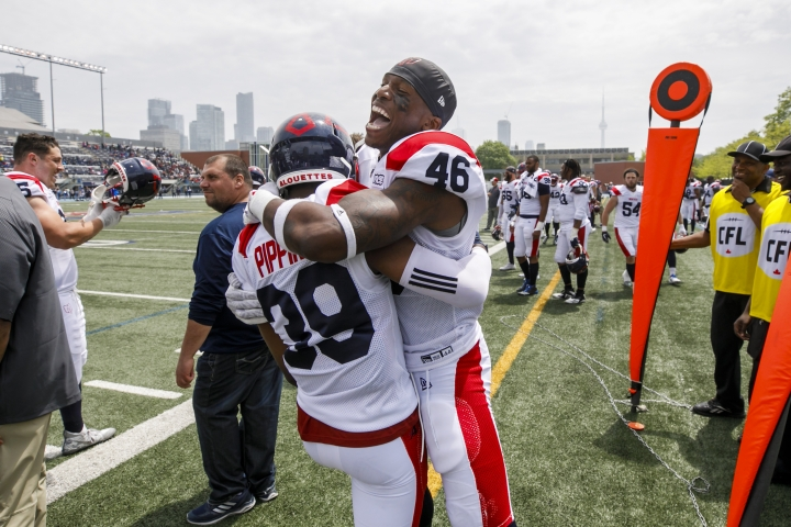 Montreal Alouettes' Marcellus Pippins is embraced by teammate Paris Taylor to celebrate Pippins' touchdown during a preseason CFL game in Toronto, Thursday, May 30, 2019. (Cole Burston/The Canadian Press via AP)