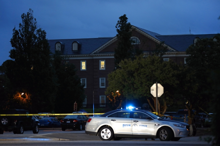 Lights shine from an upper floor of a municipal building that was the scene of a shooting, Saturday, June 1, 2019, in Virginia Beach, Va. A longtime city employee opened fire at the building Friday before police shot and killed him, authorities said. (AP Photo/Patrick Semansky)