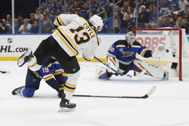 Boston Bruins center Charlie Coyle (13) scores a goal against St. Louis Blues goaltender Jordan Binnington (50) during the first period of Game 3 of the NHL hockey Stanley Cup Final Saturday, June 1, 2019, in St. Louis. (AP Photo/Jeff Roberson)