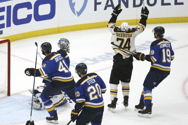 Boston Bruins left wing Jake DeBrusk (74) celebrates after teammate Patrice Bergeron, not shown, scored a goal against the St. Louis Blues during the first period of Game 3 of the NHL hockey Stanley Cup Final Saturday, June 1, 2019, in St. Louis. (AP Photo/Scott Kane)