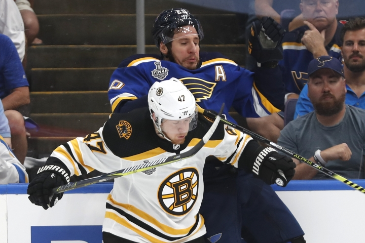 Boston Bruins defenseman Torey Krug (47) checks St. Louis Blues left wing Alexander Steen (20) during the first period of Game 3 of the NHL hockey Stanley Cup Final Saturday, June 1, 2019, in St. Louis. (AP Photo/Jeff Roberson)