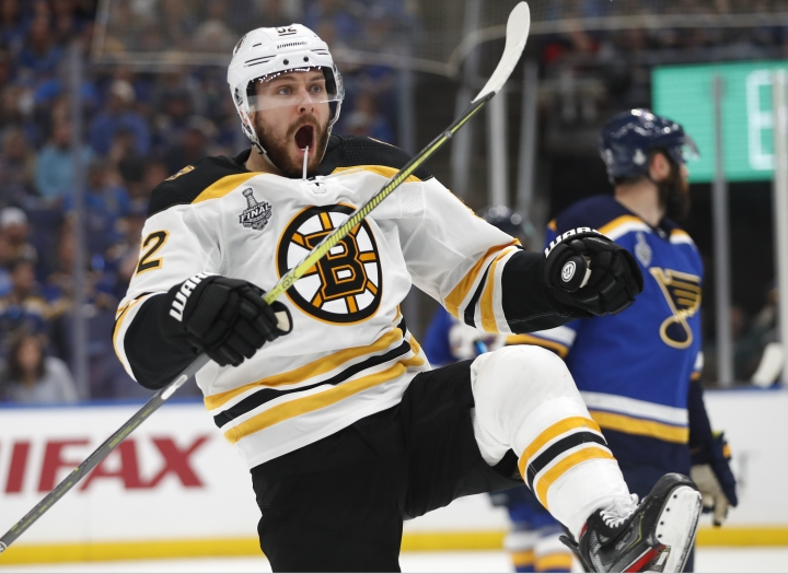 Boston Bruins center Sean Kuraly (52) celebrates after scoring a goal against the St. Louis Blues during the first period of Game 3 of the NHL hockey Stanley Cup Final Saturday, June 1, 2019, in St. Louis. (AP Photo/Jeff Roberson)