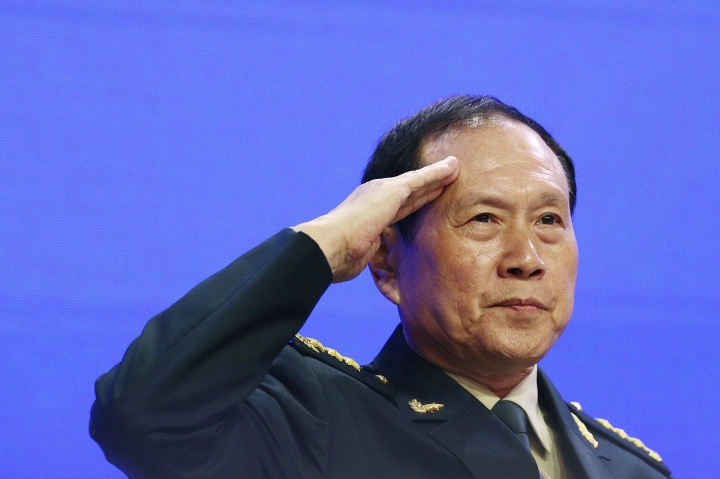 Chinese Defense Minister Gen. Wei Fenghe salutes attendees ahead of the fourth plenary session of the 18th International Institute for Strategic Studies (IISS) Shangri-la Dialogue, an annual defense and security forum in Asia, in Singapore, Sunday, June 2, 2019. (AP Photo/Yong Teck Lim)