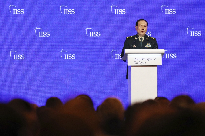 Chinese Defense Minister Gen. Wei Fenghe speaks during the fourth plenary session of the 18th International Institute for Strategic Studies (IISS) Shangri-la Dialogue, an annual defense and security forum in Asia, in Singapore, Sunday, June 2, 2019. (AP Photo/Yong Teck Lim)