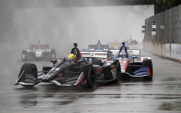 Spencer Pigot (21) leads through the eighth turn during the first race of the IndyCar Detroit Grand Prix auto racing doubleheader, Saturday, June 1, 2019, in Detroit. (AP Photo/Carlos Osorio)