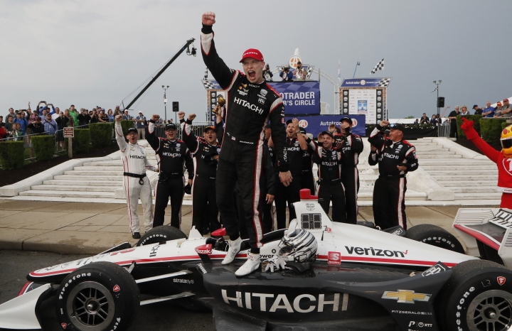 Josef Newgarden celebrates after winning the first race of the IndyCar Detroit Grand Prix auto racing doubleheader, Saturday, June 1, 2019, in Detroit. (AP Photo/Carlos Osorio)
