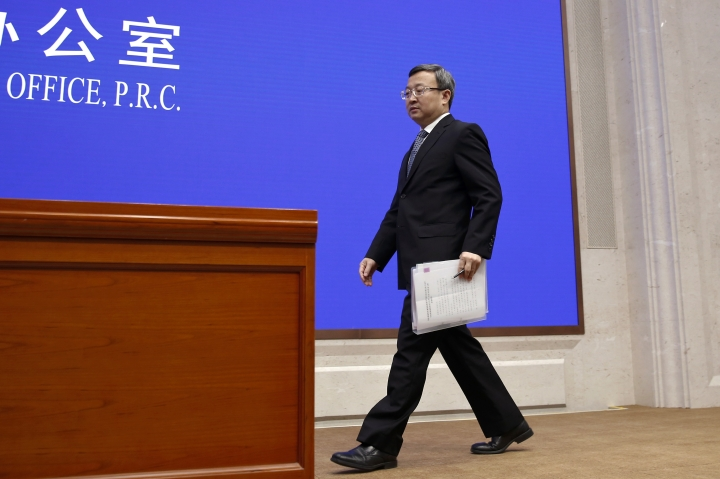 """Chinese Vice Minister of Commerce Wang Shouwen arrives to give a press conference about China-U.S. Trade issues, at the State Council Information Office in Beijing, Sunday, June 2, 2019. China has issued a report blaming the United States for a trade dispute and says it won't back down on """"major issues of principle."""" The statement from the Cabinet spokesman's office on Sunday says China has kept its word throughout 11 rounds of talks and will honor its commitments if a trade agreement is reached. (AP Photo/Andy Wong)"""