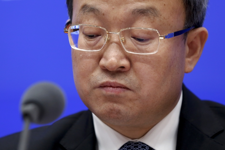 "Chinese Vice Minister of Commerce Wang Shouwen reacts as he listens a question from a journalist during a press conference about China-U.S. Trade issues, at the State Council Information Office in Beijing, Sunday, June 2, 2019. China has issued a report blaming the United States for a trade dispute and says it won't back down on ""major issues of principle."" The statement from the Cabinet spokesman's office on Sunday says China has kept its word throughout 11 rounds of talks and will honor its commitments if a trade agreement is reached. (AP Photo/Andy Wong)"