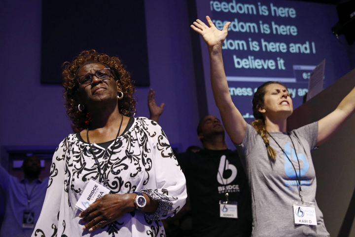 Sandra Deadwyler, left, participates in a vigil for the victims of a mass shooting at Bridge Church in Virginia Beach, Va., Saturday, June 1, 2019, in Virginia Beach, Va. DeWayne Craddock, a longtime city employee, opened fire at the municipal building Friday before police shot and killed him, authorities said. (AP Photo/Patrick Semansky)