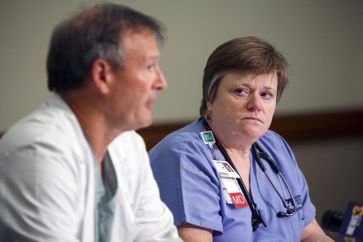 Martin O'Grady, head of trauma for Sentara Virginia Beach General Hospital, left, and Janelle Thomas, an Emergency Department physician, speak during a news conference at Sentara Virginia Beach General Hospital, Saturday, June 1, 2019 in Virginia Beach, Va. DeWayne Craddock, a longtime city employee, opened fire at the municipal building Friday before police shot and killed him, authorities said. (Kristen Zeis/The Virginian-Pilot via AP)