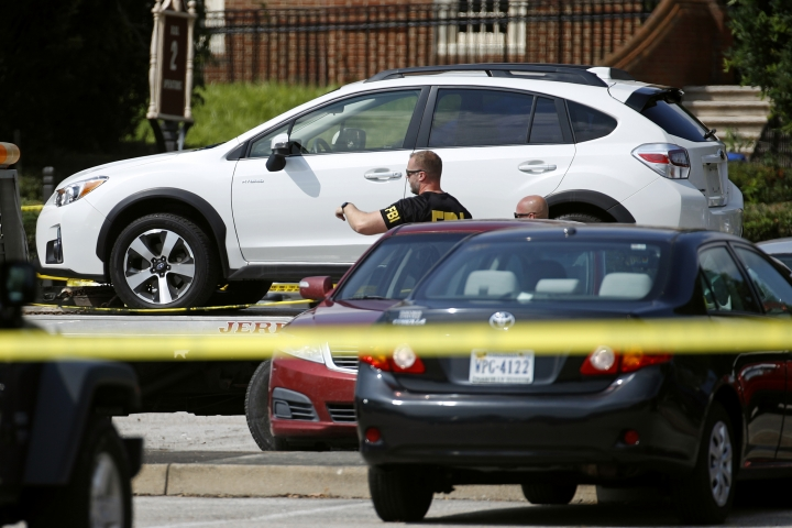 A vehicle belonging to suspect DeWayne Craddock is removed from a parking lot outside a municipal building that was the scene of a shooting, Saturday, June 1, 2019, in Virginia Beach, Va. Craddock, a longtime city employee, opened fire at the building Friday before police shot and killed him, authorities said. (AP Photo/Patrick Semansky)