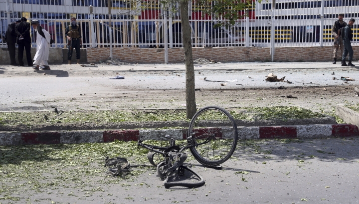 A mangled bicycle lies on the ground after an attack that targeted a bus carrying government employees in Kabul, Afghanistan, Monday, June 3, 2019. Afghan officials said a sticky bomb attached to the bus detonated in the capital. Wahidullah Mayar, spokesman for the public health ministry, said five people were killed and 10 wounded in initial casualty reports and could rise. (AP Photo/Rahmat Gul)