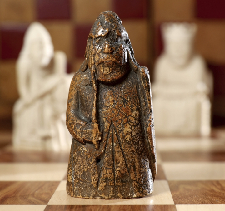 This image made available by Sotheby's on Monday June 3, 2019, shows a newly discovered Lewis Chessman on display at Sotheby's in London. The medieval chess piece purchased for five pounds by an antiques dealer in Scotland in 1964 has been found to be one of the famous medieval Lewis Chessmen and is expected to bring more than 600,000 pounds when auctioned by Sotheby's on July 2. (Tristan Fewings/Sotheby's via AP)