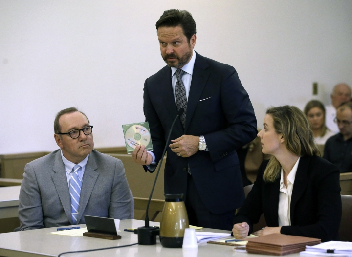 Actor Kevin Spacey, left, sits beside attorney Alan Jackson displaying a computer disk during a pretrial hearing on Monday, June 3, 2019, at district court in Nantucket, Mass. The Oscar-winning actor is accused of groping the teenage son of a former Boston TV anchor in 2016 in the crowded bar at the Club Car in Nantucket. (AP Photo/Steven Senne)