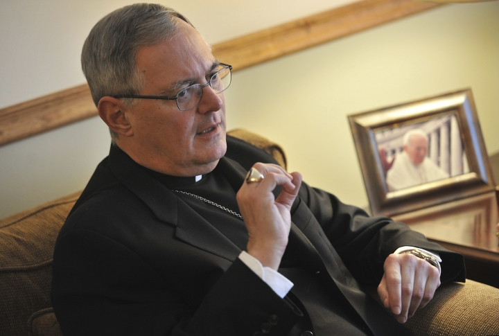 FILE - In this Nov. 22, 2009 file photo, Roman Catholic Bishop Thomas Tobin speaks to a reporter in Riverside, R.I. Tobin, Rhode Island's Roman Catholic bishop is facing backlash after tweeting Saturday, June 1, 2019 that Catholics should not support or attend LGBTQ Pride Month events. (AP Photo/Josh Reynolds, File)