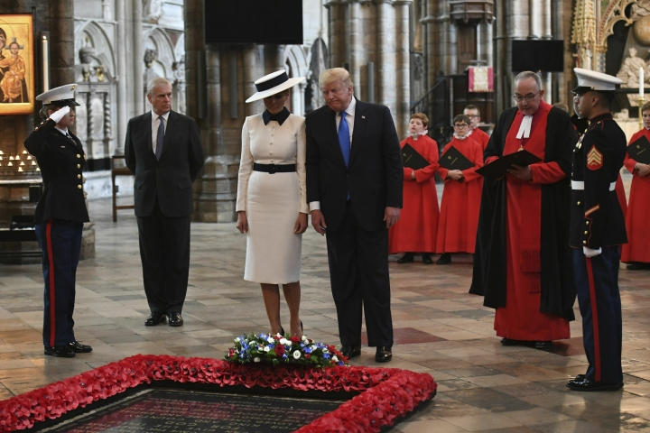 U.S President Donald Trump, accompanied by his wife Melania and Britain's Prince Andrew, second left, places a wreath on the Grave of the Unknown Warrior during a tour of Westminster Abbey in central London, Monday, June 3, 2019. Trump is on a three-day state visit to Britain. (Stefan Rousseau/Pool Photo via AP)