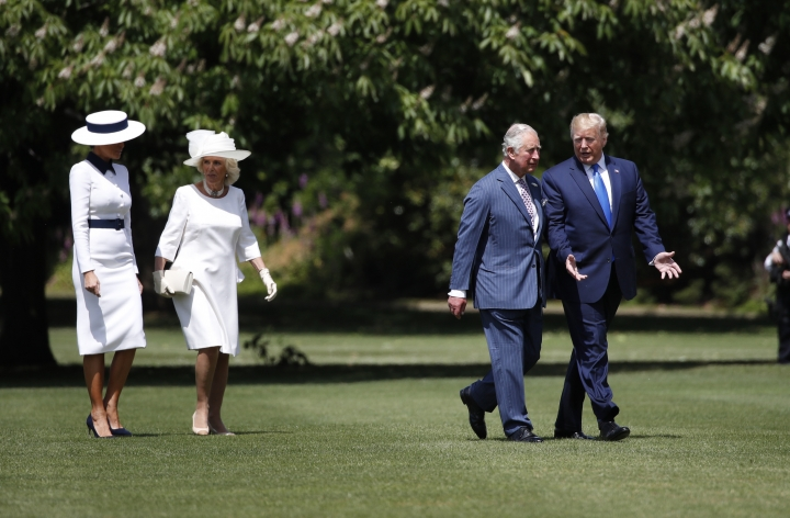 President Donald Trump walks with Prince Charles and first lady Melania Trump walks with Camilla, the Duchess of Cornwall, after arriving at Buckingham Palace, Monday, June 3, 2019, in London. (AP Photo/Alex Brandon)