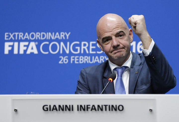 FILE - In this Friday, Feb. 26, 2016 file photo, newly elected FIFA president Gianni Infantino of Switzerland as he raises an arm during a press conference after the second election round during the extraordinary FIFA congress in Zurich, Switzerland. FIFA President Gianni Infantino this week gets a fresh four-year term to lead FIFA and world soccer in relative calm after years of turmoil. The 49-year-old Swiss-Italian lawyer's rise still rankles with those who thought the FIFA presidency was their destiny. (AP Photo/Michael Probst, File)