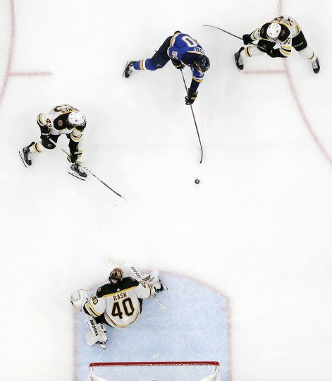 St. Louis Blues center Ryan O'Reilly (90) scores his second goal of the game against Boston Bruins goaltender Tuukka Rask (40), of Finland, during the third period of Game 4 of the NHL hockey Stanley Cup Final Monday, June 3, 2019, in St. Louis. (AP Photo/Jeff Roberson)