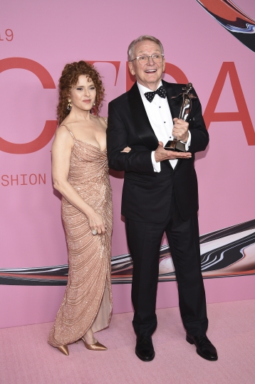 Bernadette Peters, left, and honoree Bob Mackie pose in the winner's walk with the Geoffrey Beene lifetime achievement award at the CFDA Fashion Awards at the Brooklyn Museum on Monday, June 3, 2019, in New York. (Photo by Evan Agostini/Invision/AP)