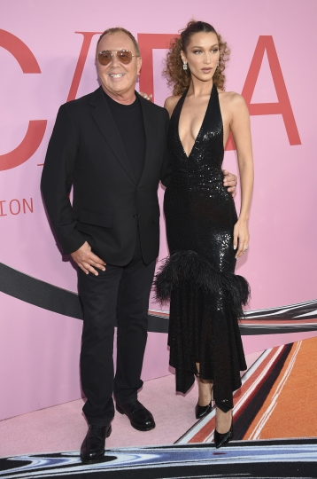 Michael Kors, left, and Bella Hadid attend the CFDA Fashion Awards at the Brooklyn Museum on Monday, June 3, 2019, in New York. (Photo by Evan Agostini/Invision/AP)