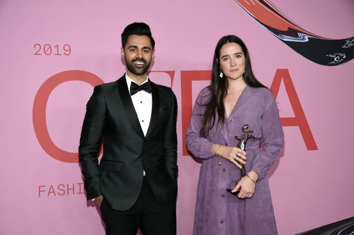 Hasan Minhaj, left, and Bode designer Emily Adams Bode pose in the winner's walk with the Emerging Designer of the Year Award at the CFDA Fashion Awards at the Brooklyn Museum on Monday, June 3, 2019, in New York. (Photo by Evan Agostini/Invision/AP)