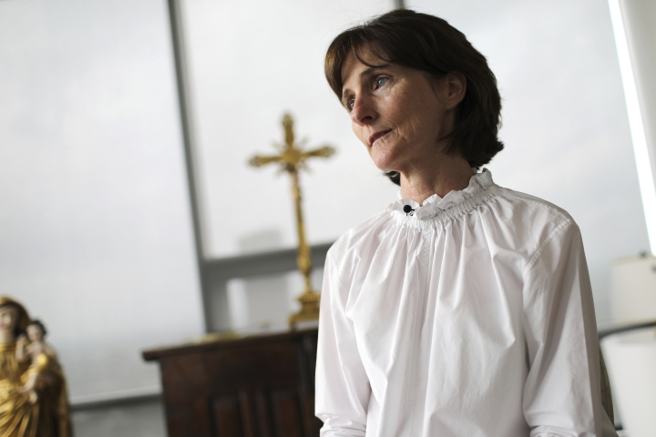Laura Pontikes pauses during an interview in the prayer section of her apartment in Houston on April 13, 2019. The 55-year-old Texas construction company executive and mother of three had been seeking God when she began spiritual counselling with Monsignor Frank Rossi. The Galveston-Houston archdiocese acknowledged a sexual relationship between Rossi and Pontikes, but asserted that it was consensual. (AP Photo/Wong Maye-E)