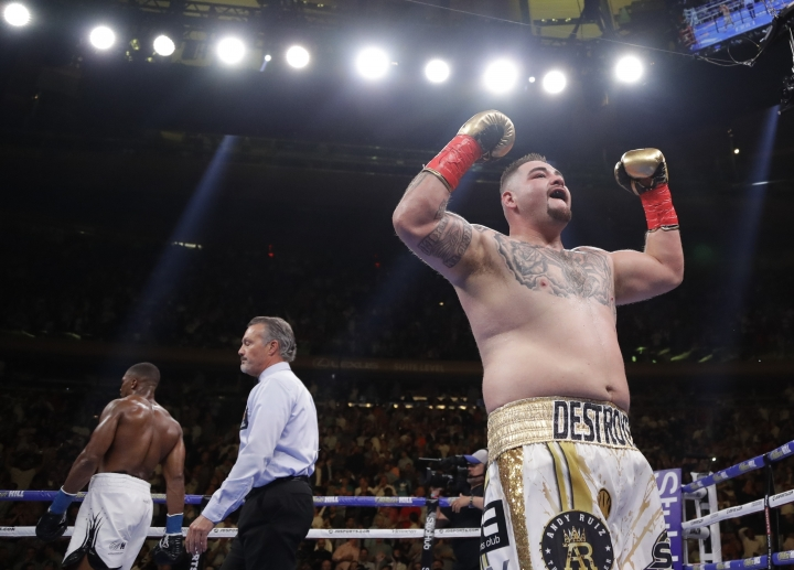 Andy Ruiz, right, celebrates after the third round of a heavyweight championship boxing match against Anthony Joshua, left, Saturday, June 1, 2019, in New York. Ruiz won in the seventh round. (AP Photo/Frank Franklin II)