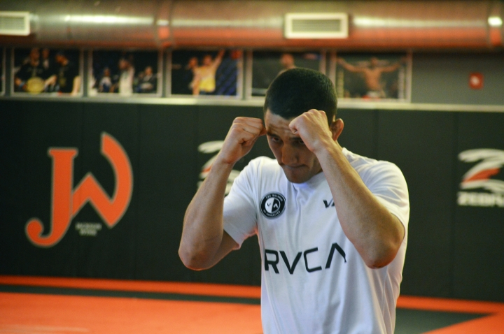 Mixed Martial Arts fighter Aaron Pico trains at the Jackson Wink MMA Academy on Monday, June 3, 2019, in Albuquerque, N.M. Pico said like many Mexican Americans he was inspired by Andy Ruiz Jr., who shocked the world Saturday by defeating Anthony Joshua in New York to became the first Mexican American boxing heavyweight champion of the world. (AP Photo/Russell Contreras)
