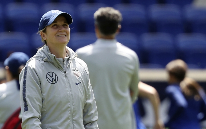 FILE - In this Saturday, May 25, 2019, file photo, United States women's national soccer team head coach Jill Ellis smiles during a training session at Red Bull Arena in Harrison, N.J. Ellis has criticized FIFA, soccer's international governing body, for scheduling two other finals, for the CONCACAF Gold Cup and the Copa America, on the same day as the Women's World Cup championship game. (AP Photo/Steve Luciano, File)