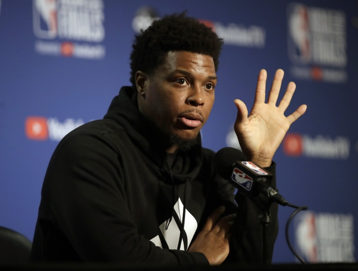 Toronto Raptors' Kyle Lowery gestures during a media conference Thursday, June 6, 2019, in Oakland, Calif. (AP Photo/Ben Margot)