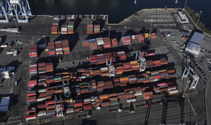 FILE - In this March 5, 2019, file photo, cargo containers are staged near cranes at the Port of Tacoma, in Tacoma, Wash. On Thursday, June 6, the Commerce Department reports on the U.S. trade gap for April. (AP Photo/Ted S. Warren, File)