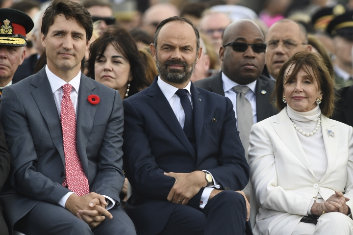 Canadian Prime Minister Justin Trudeau, left, French Prime Minister Edouard Philippe, center, and and U.S House Speaker Nancy Pelosi attend an international ceremony on Juno Beach in Courseulles-sur-Mer, Normandy, Thursday, June 6, 2019, as part of D-Day commemorations marking the 75th anniversary of the World War II Allied landings in Normandy. (Fred Tanneau, Pool via AP)